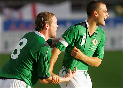 Grant McCann and David Healy celebrate Northern Ireland's opening goal