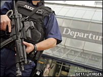 Armed officer at Heathrow airport