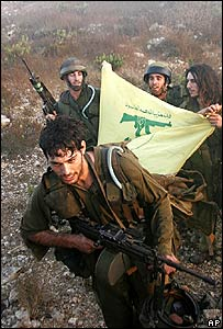 Israeli troops return from Lebanon with a captured Hezbollah flag