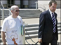 Ex-Betonsports chief David Carruthers (L) with his lawyer (R) outside court