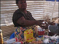 Street vendor selling goods in Luanda