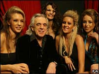 Lap dancing impresario Peter Stringfellow and employees