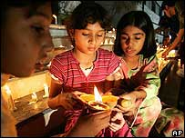 Children lighting candles in Islamabad