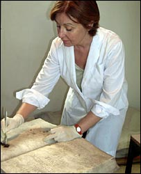 Buenos Aires City restorer Josefina Crepy working on 19th century gravestone