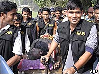 RAB personnel with captured militant leader Bangla Bhai
