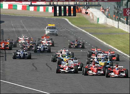 The start of the Japanese Grand Prix - Felipe Massa (right) leads from Michael Schumacher (second right)