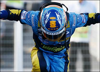 Fernando Alonso celebrates victory in the Japanese Grand Prix, which puts him on the brink of the world title