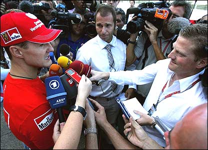 Michael Schumacher faces German TV crews after his retirement from the Japanese Grand Prix
