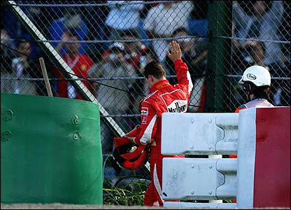 Michael Schumacher waves to his fans after retiring from the Japanese Grand Prix