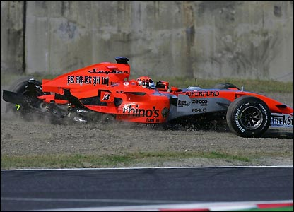 Christijan Albers spins to a halt after the suspension of his Midland collapses