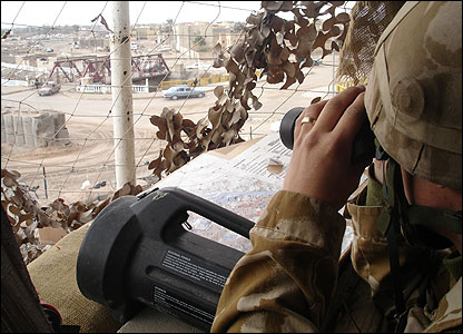 Soldier keep watch from a Basra base