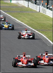 Michael Schumacher takes the lead of the Japanese Grand Prix as Felipe Massa lets him by