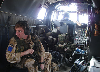 Soldiers on board a helicopter