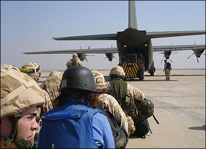 Passengers waiting to board a Hercules plane