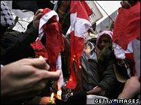 Danish flag burned outside embassy in London