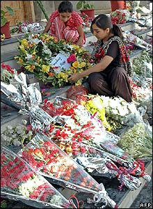 Pakistani relatives of earthquake victims lay flowers in Islamabad