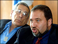 A picture from 2001 shows Avigdor Lieberman on the right, with Rehavam Ze-evi on the left