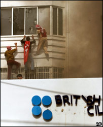 Palestinians scale the burning British Council in Gaza City