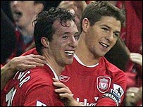 Robbie Fowler (left) celebrates his opener in Liverpool's 3-1 win against Fulham with captain Steven Gerrard