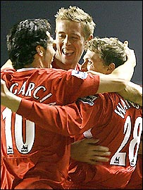 Luis Garcia (left) and Peter Crouch (centre) celebrate with defender Stephen Warnock, who scored his first goal for the club in the 5-1 win over Fulham