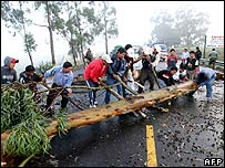 Indians block the Pan American Highway with tree trunks