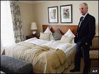 Sven-Goran Eriksson looks at a bedroom in the Schlosshotel Buhlerhohe