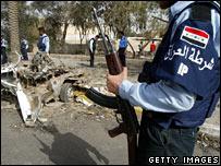 An Iraqi policeman holding a gun