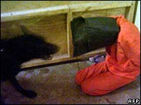 Picture from SBS TV in Australia showing dog and                                     Abu Ghraib prisoner