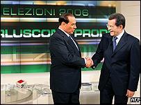 Prime Minister Silvio Berlusconi (L) shakes hands with opposition leader Romano Prodi