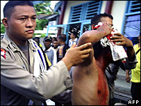 Injured policemen at the Papua riots