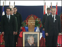 Socialist Party officials form an honour guard round the coffin