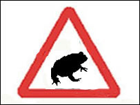 Toad in road sign