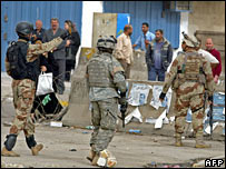 US and Iraqi soldiers at the site of a car bomb attack in Baghdad on 9 March