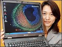 Lenovo employee shows off its new notebook computer