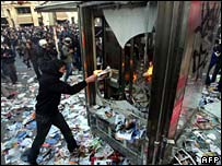 Protester sets fire to phone box