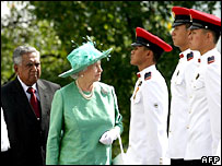 The Queen inspecting the guard of honour in Singapore
