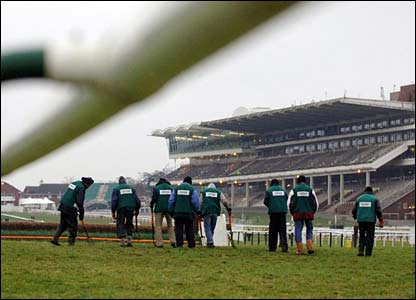 Ground staff prepare the course on the last day at Cheltenham