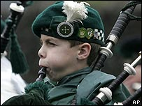 A bagpiper at a St Patrick's Day parade in West Orange, New Jersey, USA