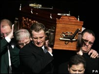 Jimmy Johnstone's coffin leaves the church
