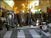 Riot police advance over barricades in Paris
