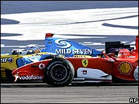 Fernando Alonso emerges from the pits just in time to hold off Michael Schumacher for victory in the Bahrain Grand Prix