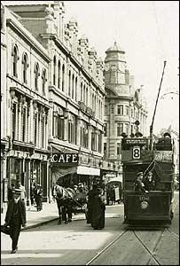 A tram running through Queen Street
