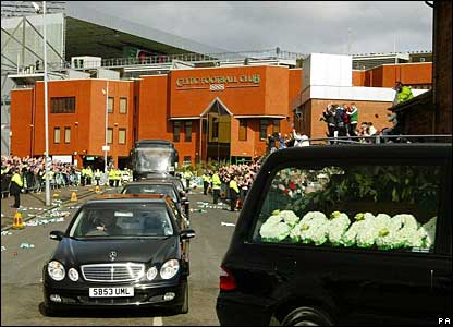 The funeral cortege drives past Celtic Park stadium in Glasgow
