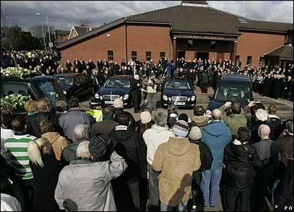 Fans gather outside St John's the Baptist Church in Uddingston