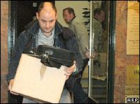 Belgian investigators remove documents from raided premises