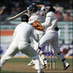 Strauss is caught by Mahendra Dhoni
