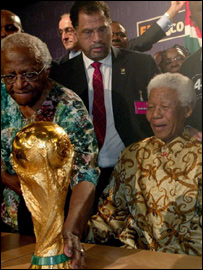 Mandela and Desmond Tutu with the World Cup trophy
