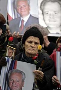 Milosevic supporter surrounded by posters