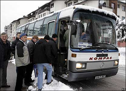 Mourners get on bus in Pale, Bosnia, to attend funeral