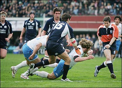 Italy's Mirco Bergamasco scores the opening try of the match